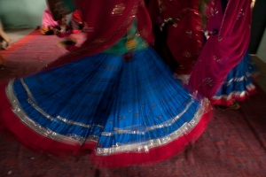 Traditional Rajasthani Skirts swirling at a celebration by Mark Tuschman