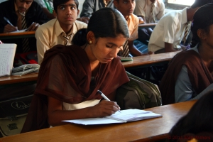 A young girl hard at work during her lesson at school