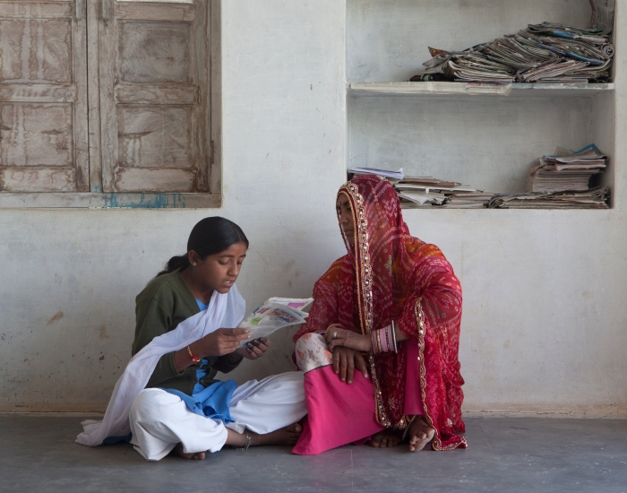 Chaddi reads to her mother by Mark Tuschman