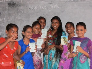 Padma, a proud Team Balika, with young girls from the school in her village.