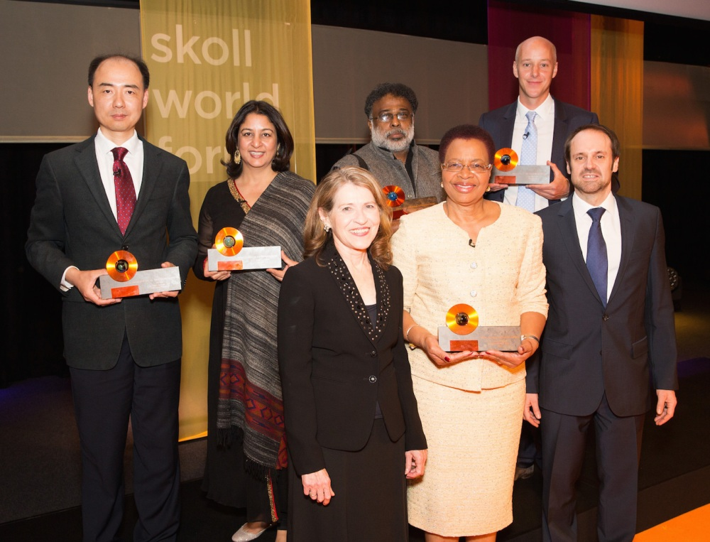 2015 Skoll Award for Social Entrepreneurship Winners, from left to right, back row, Ma Jun, Executive Director and Founder of Educate Girls Safeena Husain, Jagdeesh Rao Puppala & Al Harris, joined on the front row, from left to right, by Sally Osberg, Graça Machel & Jeff Skoll.